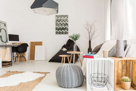 wall decor: Cosy minimalist living room with wooden furnitures white walls