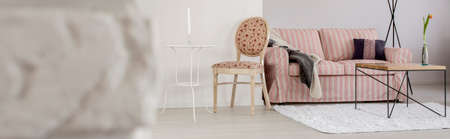 upholstered: Light flat interior with red sofa and upholstered chair