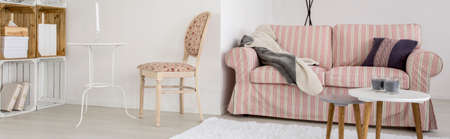 living room sofa: Living room with chair, crate regale and sofa