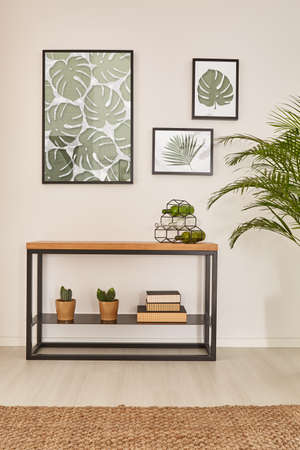 wall decor: Monstera leaf wall decor, furniture made from wood and metal Stock Photo