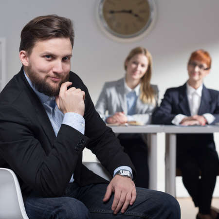 traineeship: Elegant smiling businessman  in suit with his colleagues in office
