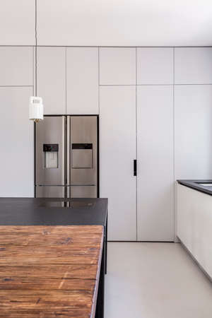 steely: Simple functional kitchen with white walls and steel furniture Stock Photo