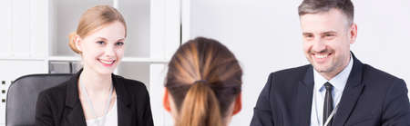recruiters: Panoramic picture of smiling recruiters talking to an applicant for a job Stock Photo