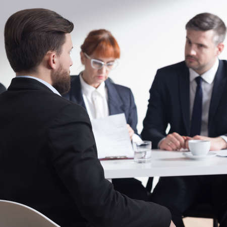 recruiters: Corporation recruiters talking with a job applicant Stock Photo