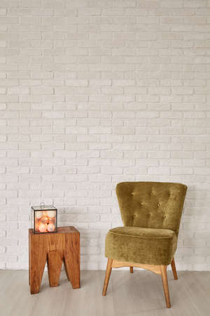 modern chair: Room with decorative cotton balls, side table and green armchair