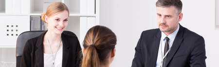 recruiters: Shot of two recruiters and an applicant during a job interview