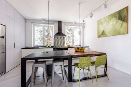 steely: Modern and light kitchen with different dining tables in futuristic style