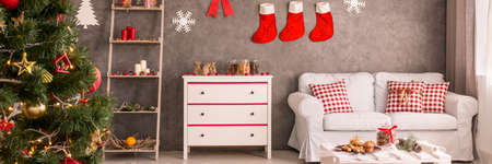 cozy christmas decor in modern living room stock photo 67708431 - Cozy Christmas Decor