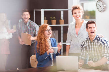 first job: Happy business team and positive work environment Stock Photo