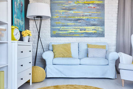 furnished: Cozy furnished living room with big painting on a wall Stock Photo