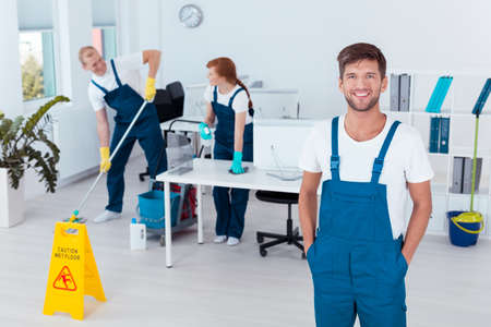 Group of young cleaners working in an office