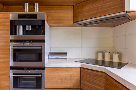 inductive: Close-up of modern kitchenette with wooden furniture