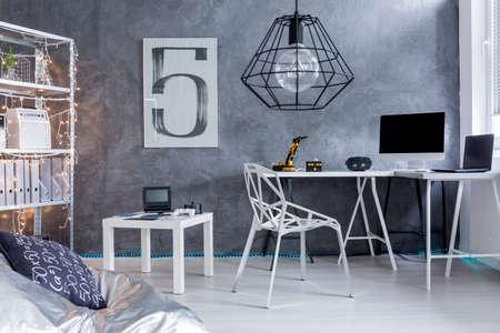 modern home: Shot of a modern grey home office Stock Photo