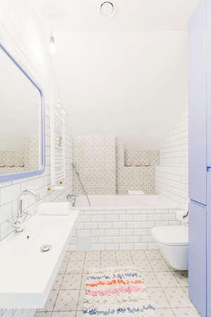 lightsome: Bright modern bathroom with a toilet, bathtub, sink and mirror