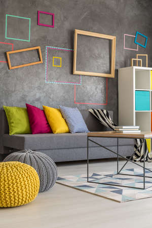room decor: Stylish decor of new grey living room with colorful decorations