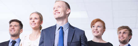 executive woman: Bright panorama of a business team with a confident young leader Stock Photo