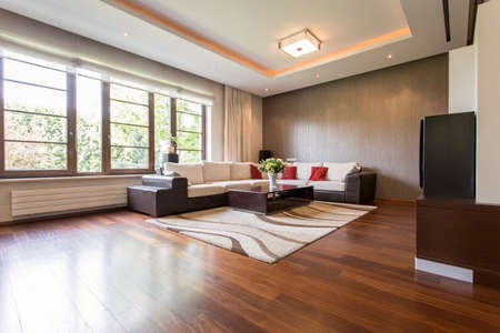 living room design: Modern living room design with brown parquet