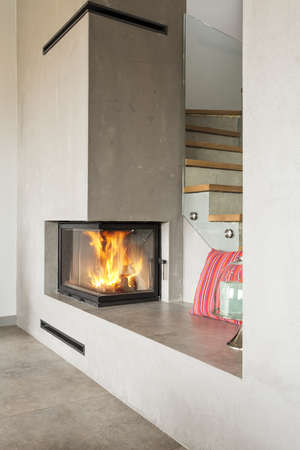 lightsome: Close-up of burning fireplace in luxury living room