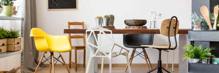 home accessories: Mix of chairs and wooden table in modern dining room