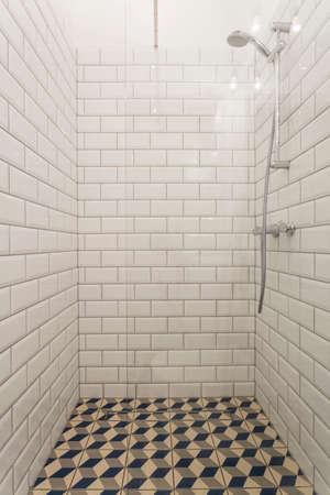 bathroom tiles: Black and white tiles in modern bathroom