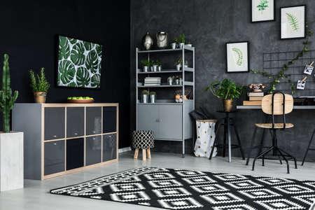 Room corner of modern flat with cyan wall