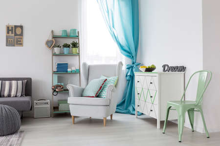 lightsome: Bright and comfortable living room with mint chair and white armchair