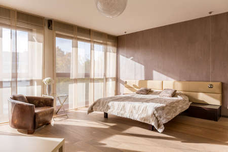 bedroom bed: Spacious bedroom interior with marital bed Stock Photo