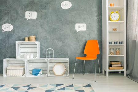 Attirant Room With Orange Chair, Crate Furniture And White Regale Stock Photo    68444728