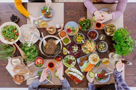 Various vegan and vegetarian food lying on rustic table Banco de Imagens