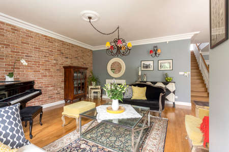 comfort room: Rustic cozy living room with piano, sofa and brick wall