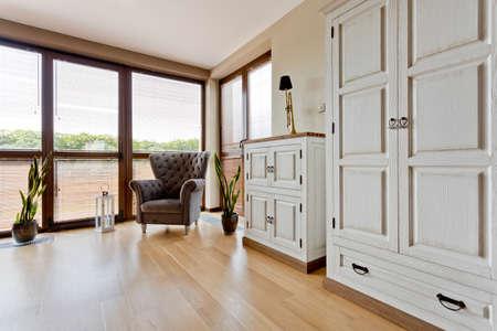 comfort room: Stylish room with big windows and vintage elegant furnitures