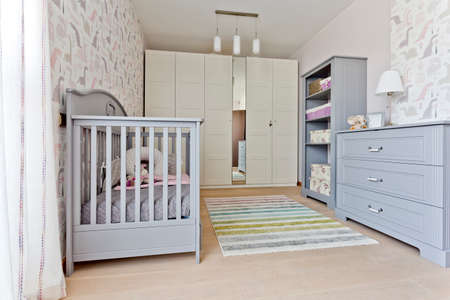 comfort room: Modern universal nursery with grey babcy cot, built-in wadrobe and commode