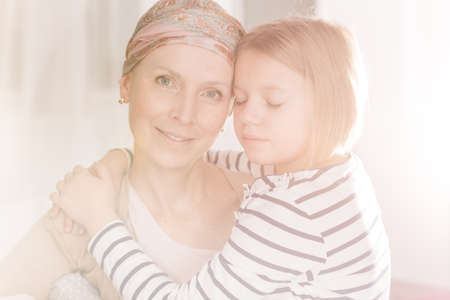 leukemia: Young cancer woman with headscarf having her family support