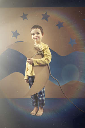 visualise: Kid in pyjamas with a paper moon