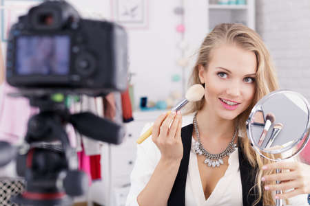 Beautiful make up vlogger with mirror recording tutorial