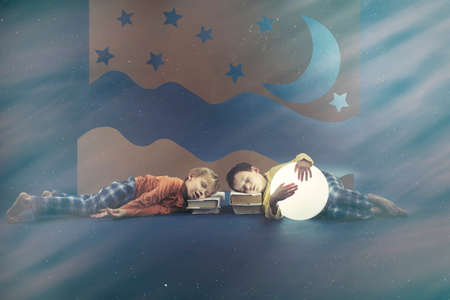 visualise: Tired young boys sleeping on books Stock Photo