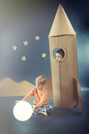 visualise: Night sky with a boy in paper rocket