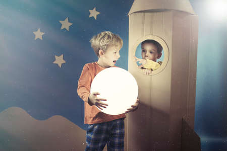 visualise: Boy showing the shining ball to his friend