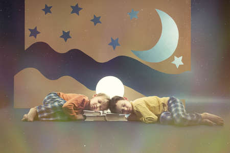 sleepiness: Children dreaming at night with the moon above Stock Photo