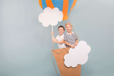 visualise: Friends flying in balloon among clouds