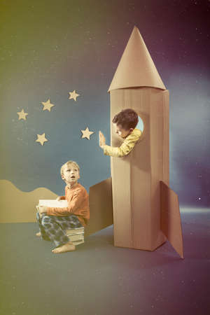 visualise: Young boys with paper rocket