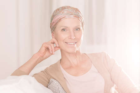 Young woman with positive attitude suffering from cancer Stock Photo