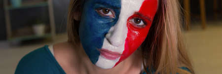 Sad and dissapointed French football fan after the game Stock Photo