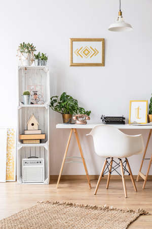 Modern home office area with desk and armchair