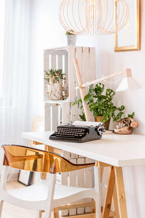 Home office area with typewriter on a desk Stock Photo