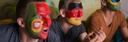 world championship: Football fans watching the world championship with painted faces
