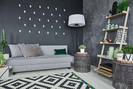 wall decor: Room with black cactus wall decor and sofa