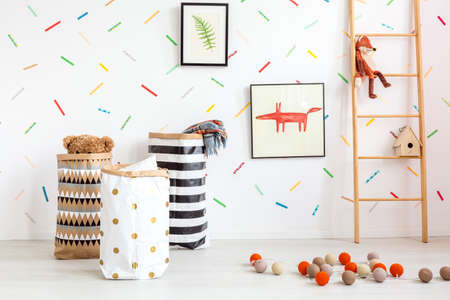 White child room with decorative cotton balls and toys Stockfoto