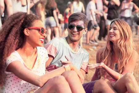 open air: Happy friends with colored clothes and faces relaxing outdoors Stock Photo