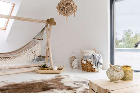 White room with hammock, window and wooden accessories Reklamní fotografie